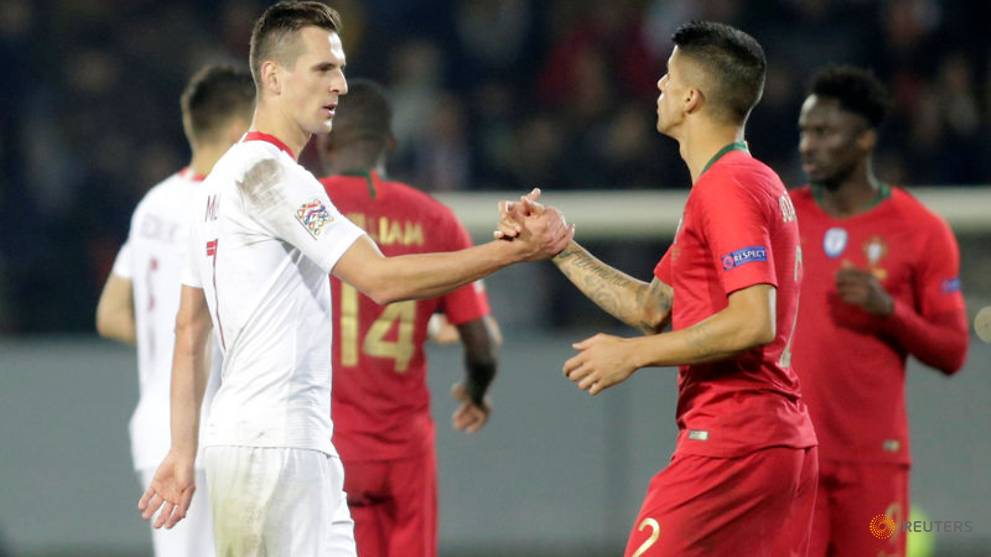 Milik s twice-taken penalty gives relegated Poland draw in Portugal -  Channel NewsAsia 0cf8feb4fd9fc