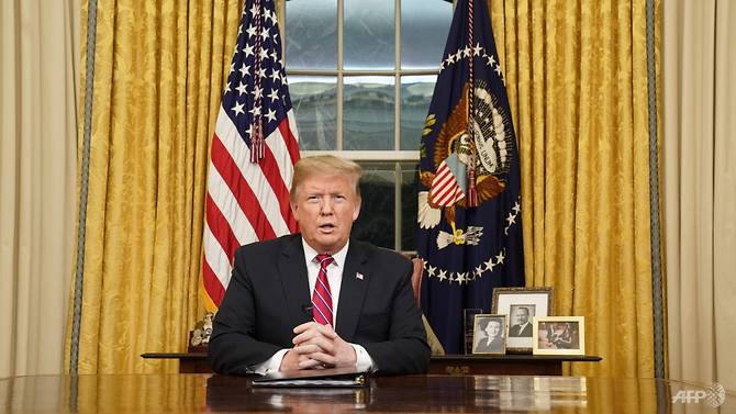 Donald Trump delivers an address from Oval office on Jan 8, 2019