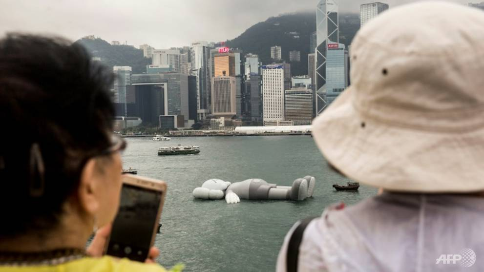 Giant floating KAWS sculpture arrives in Hong Kong harbour