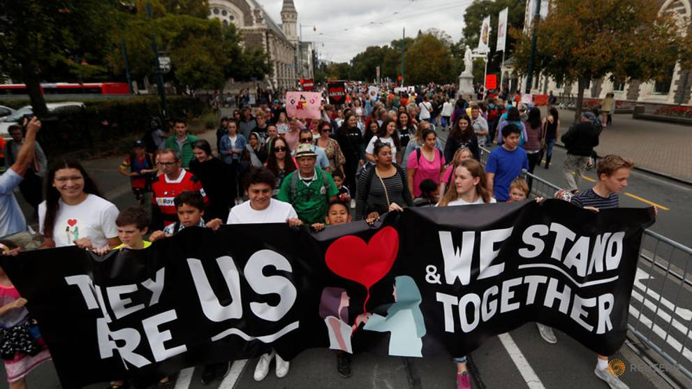 New Zealand reopens mosques that were attacked; many 'march for love'