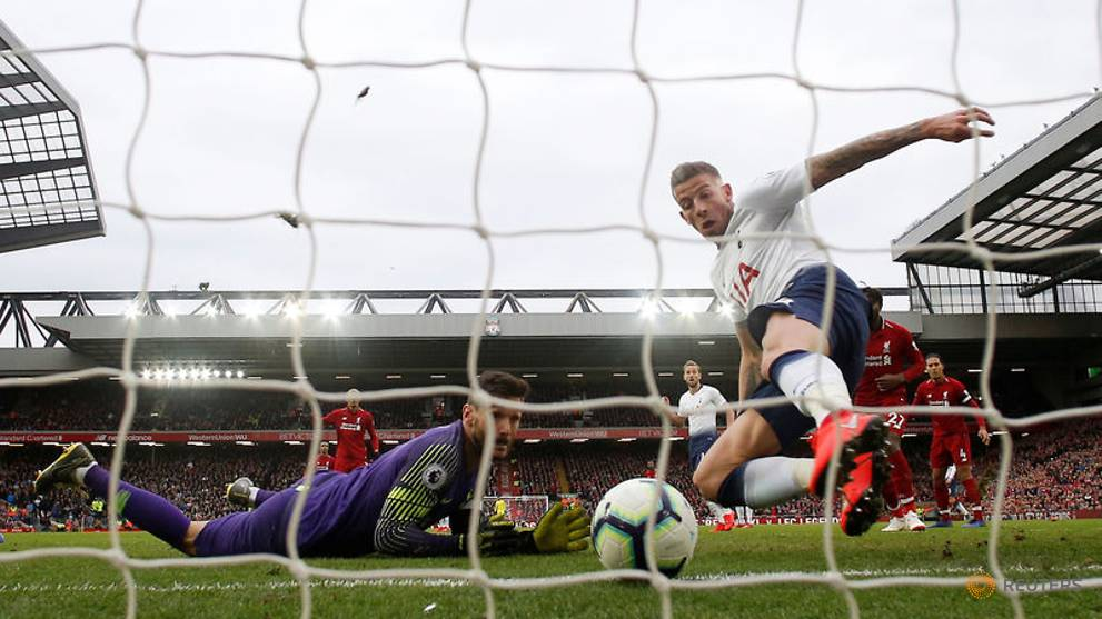 Late own goal gives Liverpool vital win over Spurs - CNA