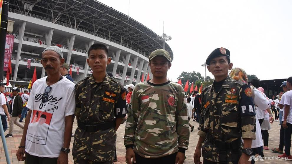 Election enforcers: Paramilitary groups for Jokowi and Prabowo flex