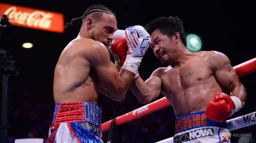 Boxing: Manny Pacquiao beats Thurman on split decision - CNA