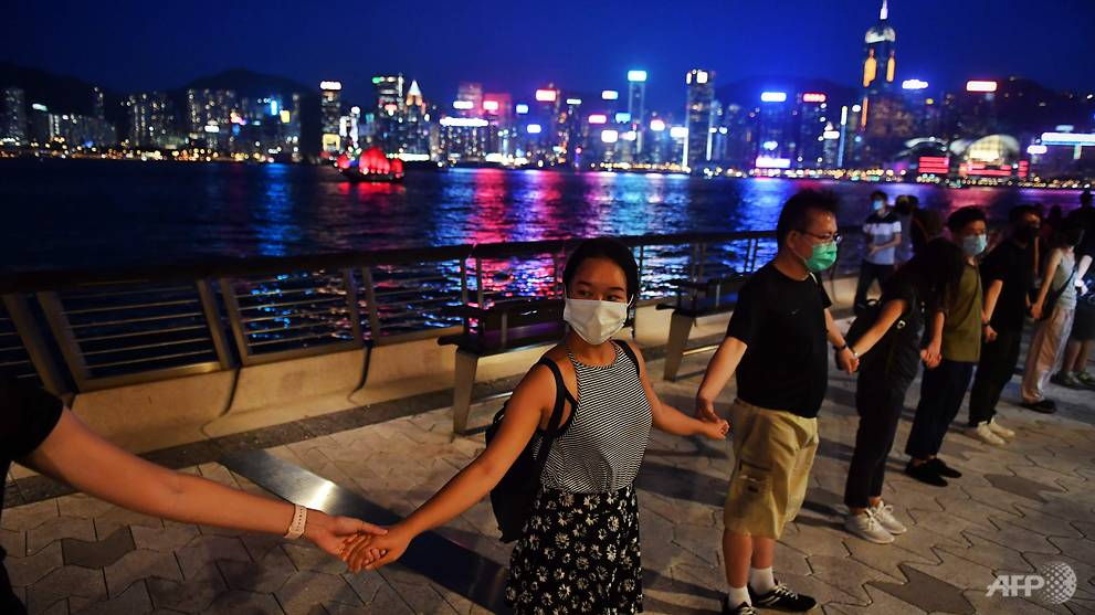 Hong Kong protesters form massive human chain across the city