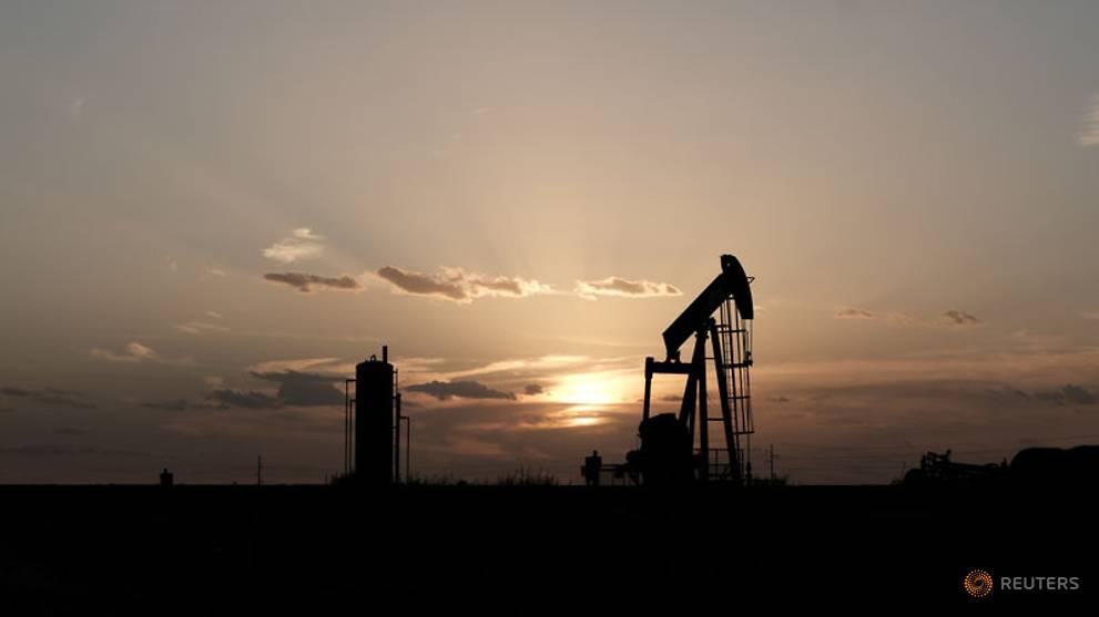 file photo  oil pump jacks work at sunset near midland 1