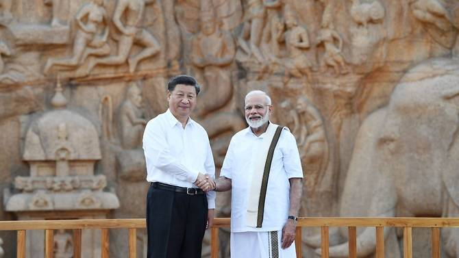 Xi and Modi held several hours of one-on-one talks in a southern seaside Indian town