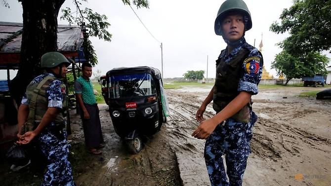 file-photo--myanmar-police-officer-stands-guard-in-maungdaw--rakhine-1.jpg