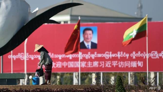 Billboards and banners welcomed China's Xi Jinping to Naypyidaw on Friday