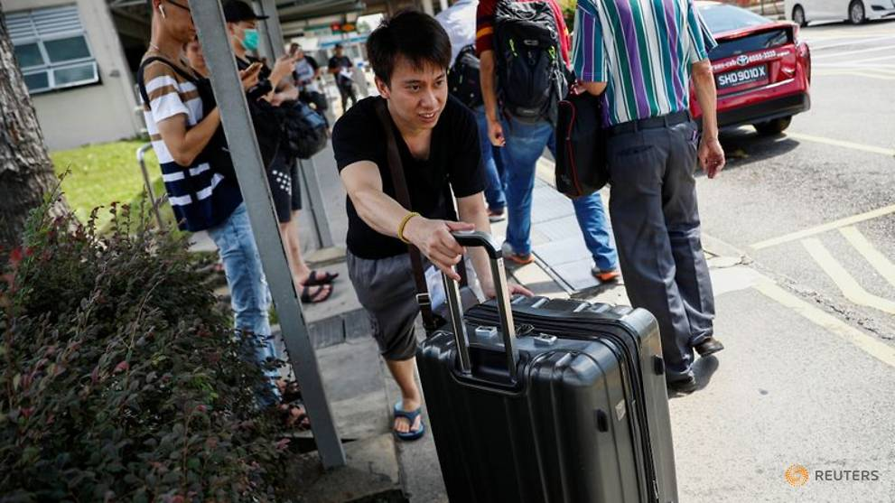 Singapore firms rush to house Malaysian workers before COVID-19 travel restrictions kick in