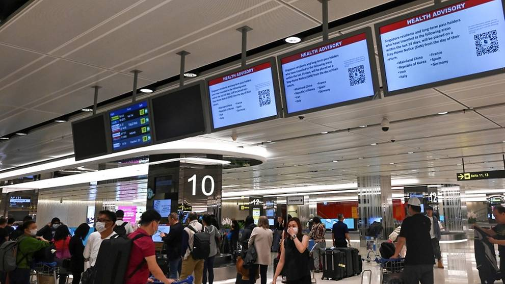 Companies urged to impose leave of absence for staff who travelled during March holidays: MOM