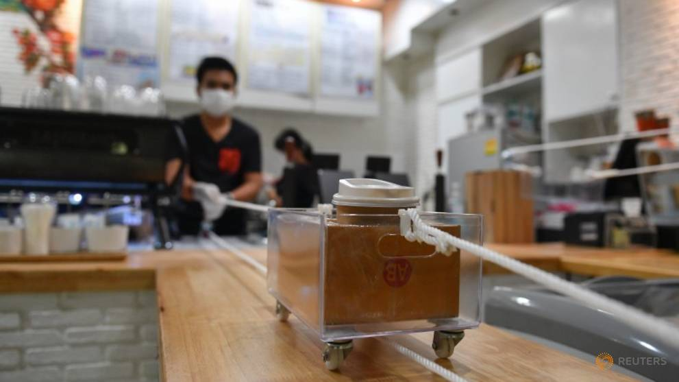 Thai cafe serves coffee on wheels to maintain social distance amid COVID-19 outbreak
