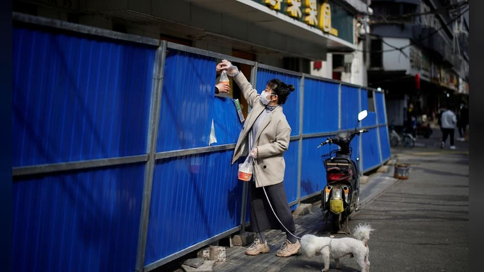Shoppers shout over walls in China's Wuhan as COVID-19 lockdown lifts
