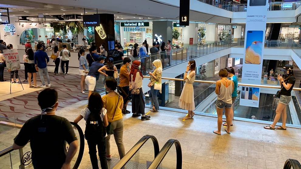 Long queues at some malls as shoppers rush to prepare for closure of schools and most workplaces