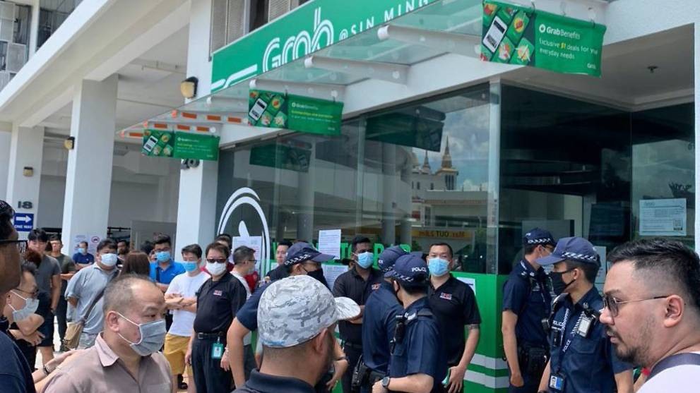 Grab forced to close centre after crowd forms to collect food delivery bags amid COVID-19 measures