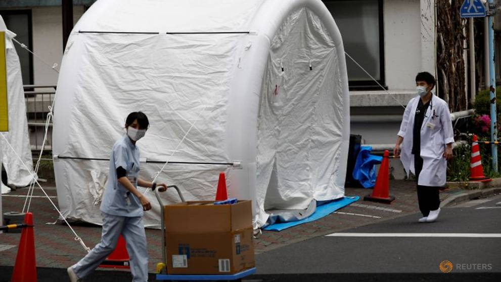 As COVID-19 infections mount, Japan at last expands testing