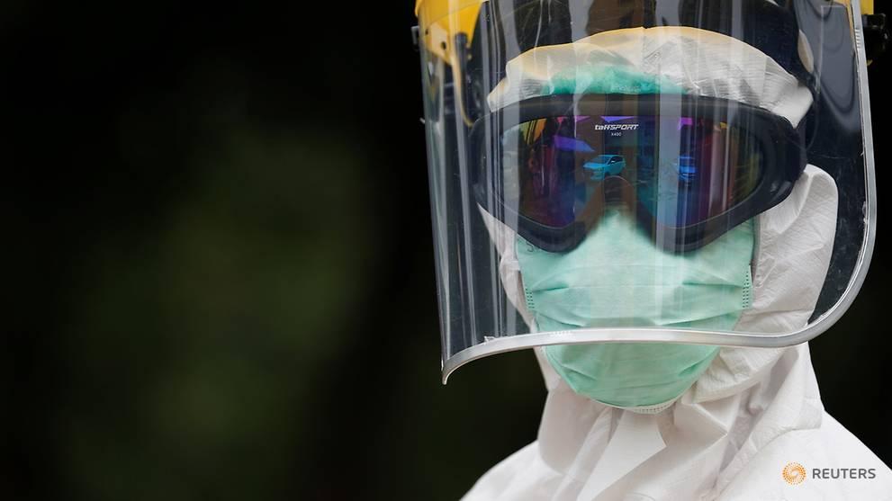 Indonesia says coronavirus infections rise above 10,000