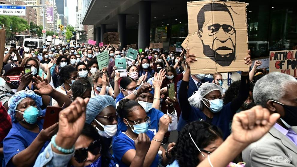 'They are the heroes now': COVID-19 doctors join racism protests