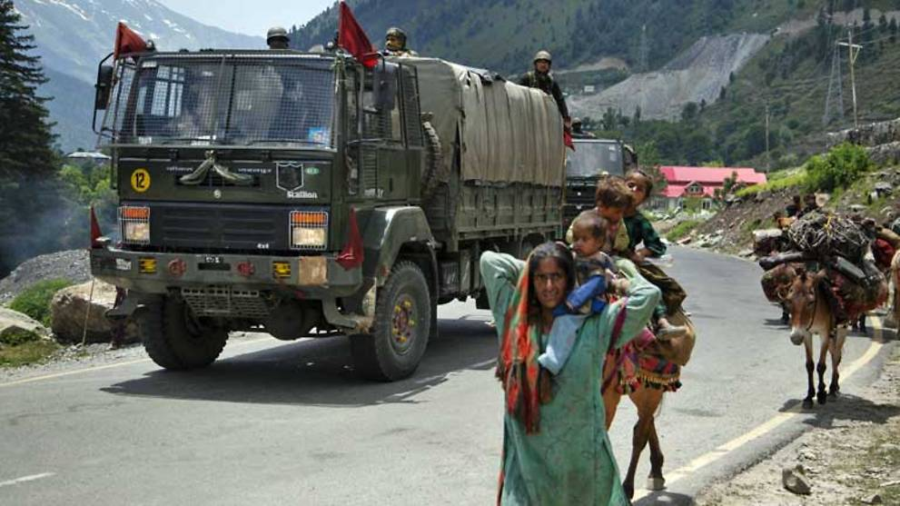 India accuses China of amassing troops along border in violation of agreements