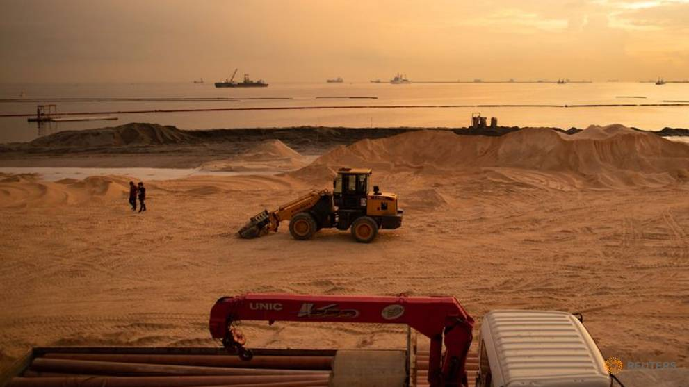 Polluted stretch of Manila Bay gets fake white sand makeover