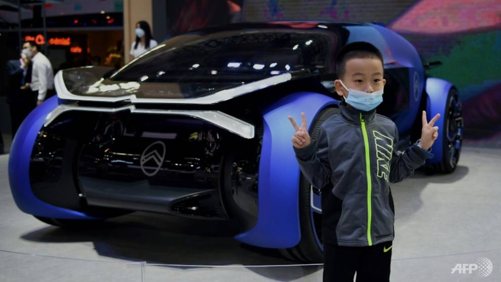 Crowds in face masks pack out China auto show after COVID-19 delay