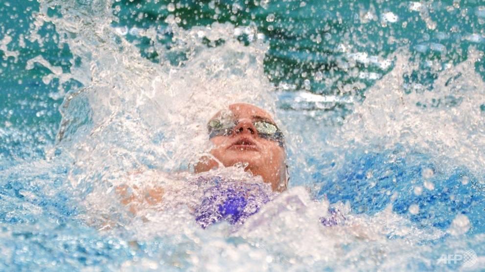 Swimming: Australia's McKeown smashes women's 100m ...