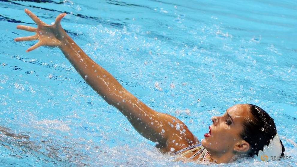 Spanish swimmer says forced to leave breastfeeding son at home