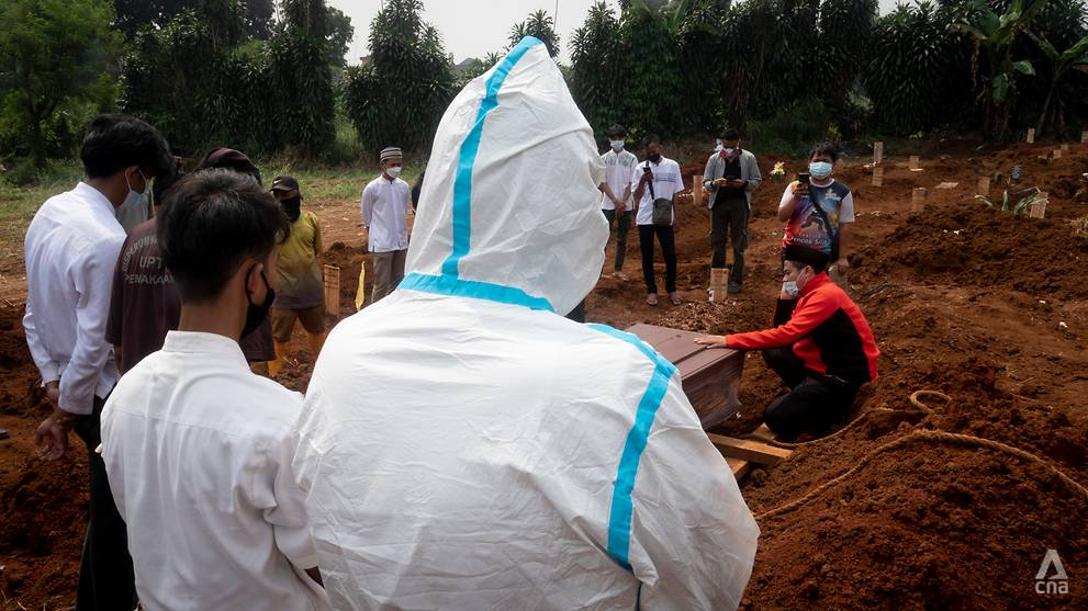 Bogor volunteers bury those who died at home, as COVID-19 stretches Indonesia's healthcare system