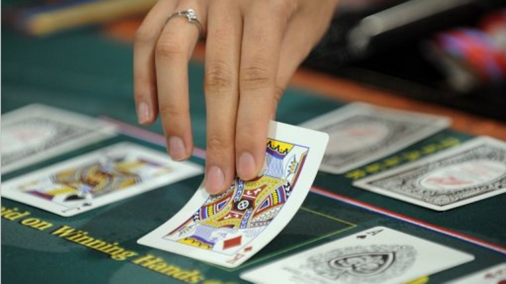 Jail and fine for trio who set up online poker club using mobile app