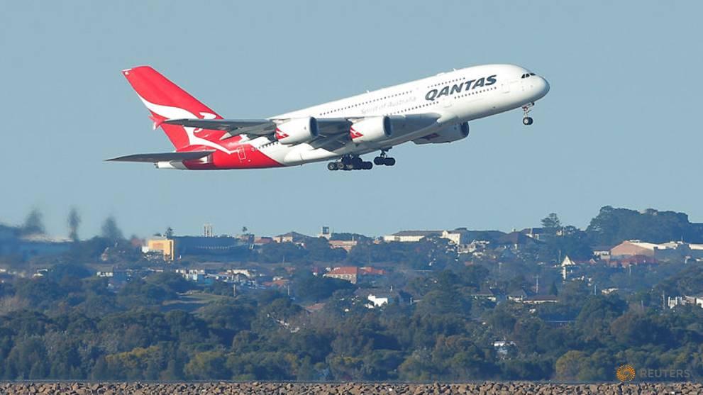 Qantas says no international flights until October, reports billions in losses