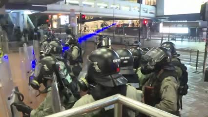 Hong Kong police fire tear gas at protesters in train station