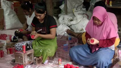 Business is bright for candle-makers in Indonesia during Chinese New Year | Video
