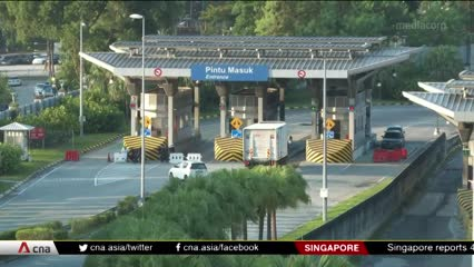 Malaysian workers uncertain about future in Singapore | Video