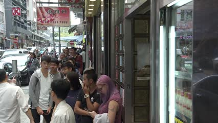 Hong Kong's anti-government protesters target shop owners | Video
