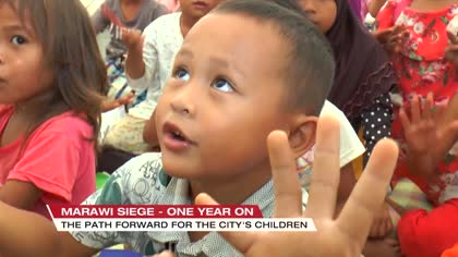 Marawi children find ways to make up for stolen year