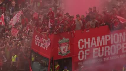 Football: Liverpool turn red for Champions League homecoming party | Video