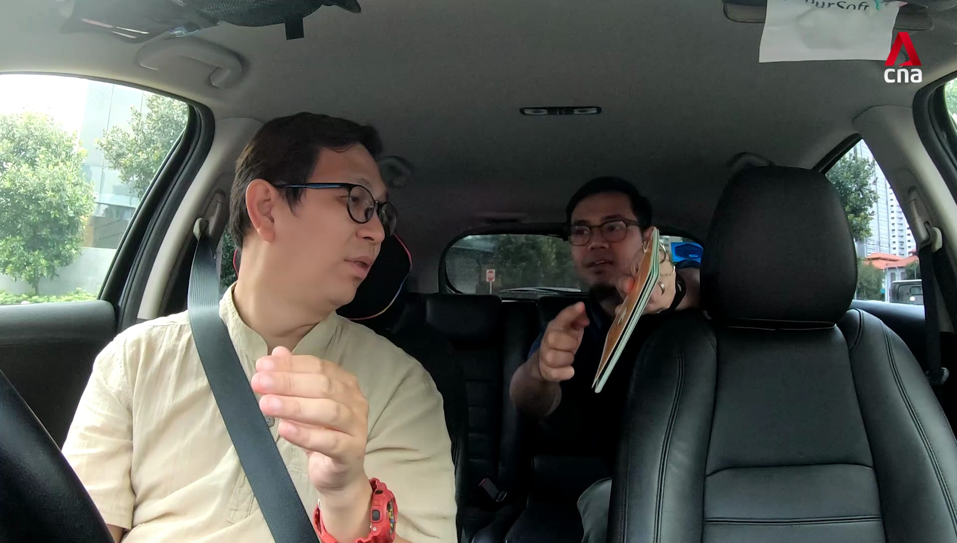 On the road with a deaf Grab driver in Singapore | Video